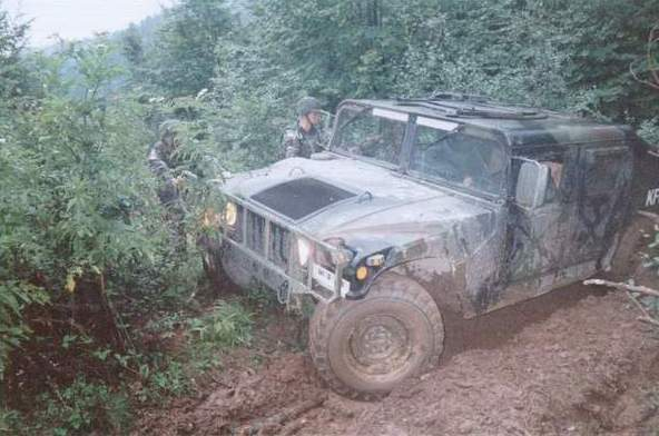 1492 humvee in the mud