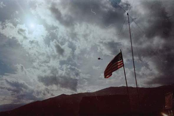 641Flag with helicopter in the distance