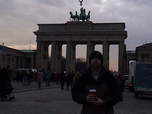 Larry in front of Brandenburg Gate.