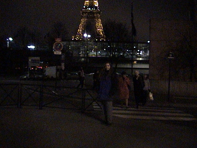 Holly in front of Eiffel Tower at night
