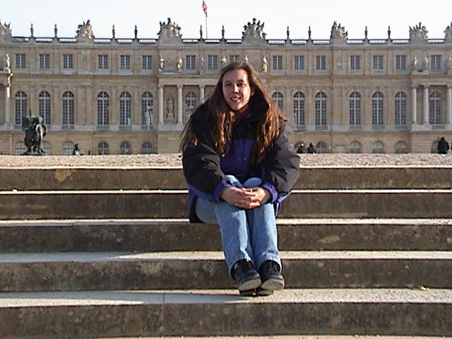 Holly sitting on steps at Versailles.