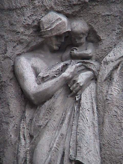 Stone carving of woman and child.